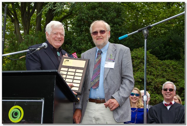 U.S. Representative Jim McDermott presenting with 2014 winner Jens Lund